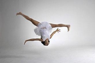 Aerial cartwheel - A dancer in mid-air performing an aerial cartwheel