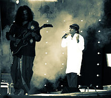 Singer and guitarist in front of effects smoke