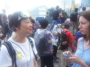 2014 Hong Kong protests - Mask and ribbon-equipped democracy protester, Civic Party committee member and former legislator Audrey Eu interviewed on Lung Wui Rd near Tim Mei Ave, 10.53 am 28 September 2014