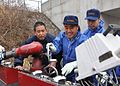 110315-F-YC711-090 instructing Fukushima firefighters on how to operate American fire engine.jpg