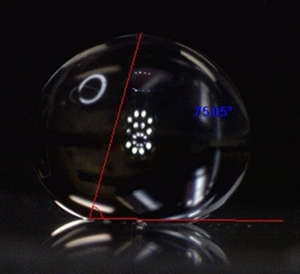 Hydrophobe - 165 degree water contact angle on a surface modified using plasma technology system surface chemistry. The contact angle is the red angle plus 90 degrees.