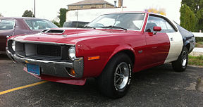 Shows a 1970 Javelin Trans-Am finished in the factory red/white/blue paint scheme