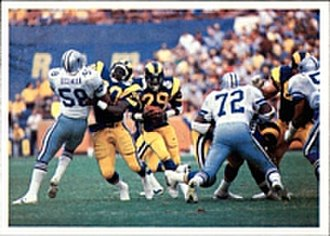 1985 NFL season - Rams' running back Dickerson (29) rushing the ball through the Cowboys' defense in the 1985-86 NFC Divisional Playoffs Game .