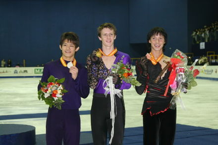 Abbott and his fellow medalists at the 2008-2009 Grand Prix Final.