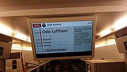 Nyhetsmelding i toget til Lillehammer.