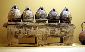 Greek Dark Ages - Geometric-style box in the shape of a barn. On display in the Ancient Agora Museum in Athens, housed in the Stoa of Attalus. From early geometric cremation burial of a pregnant wealthy woman, 850 BC.