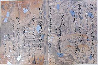 "Paper marbling - Two pages of ''waka'' poems by Ōshikōchi Mitsune (859?–925?). 20 cm height, 32 cm wide. Silver, Gold, Color, and ink on suminagashi paper. From a copy of the Sanjurokunin Kashu or ""Thirty-Six Immortal Poets"" kept in the Hongan-ji Temple, Kyoto. This multi-volume manuscript, which contains the oldest examples of marbled paper known today, was presented to the Emperor Shirakawa on his sixtieth birthday in 1112 C.E. (Narita, 14 and Chambers, 13–16)."