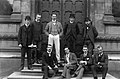 9 men in front of ornate door, Trinity College, Dublin (20320358000).jpg