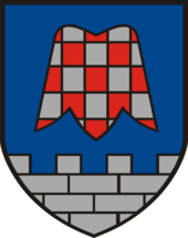Coat of arms of Großsteinbach in Austria, depicting a stylised flower of Fritillaria meleagris
