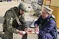 A Georgian soldier with Alpha Company, Special Mountain Battalion renders first aid to a simulated injured civilian role player Feb. 18, 2014, during Georgian Mission Rehearsal Exercise (MRE) 14-02B at the Joint 140218-A-RJ750-006.jpg