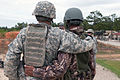 A U.S. Army paratrooper with the 82nd Airborne Division's 1st Brigade Combat Team and an Indian Army soldier with the 99th Mountain Brigade pose for a photograph following weapons training at Fort Bragg, N.C..jpg