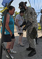 A U.S. Soldier, right, checks Debbie Cox, left, a role player, during exercise Vibrant Response 13 at the Muscatatuck Urban Training Center at Camp Atterbury, Ind., July 29, 2012 120729-A-WW110-010.jpg