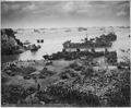A formidable task force carves out a beachhead, about 350 miles from the Japanese mainland. Landing craft of all... - NARA - 513221.tif