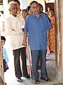 A handicap person standing in the queue to cast his vote at a polling booth in the Guwahati Parliamentary Constituency, Assam during the first phase of General Elections-2004 on April 20, 2004.jpg