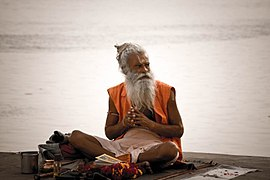 A sadhu by the Ghats on the Ganges, Varanasi.jpg