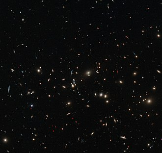 Galaxy groups and clusters - MACS J0152.5-2852 is a massive galaxy cluster. Almost every object seen in the image is a galaxy, each containing billions of stars.
