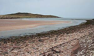 Achnahaird - Achnahaird Bay, Wester Ross, looking across the bay where Allt Loch Raa enters the sea. The low hill on the other side of the bay is the imaginatively named Cnoc Mòr ('big lump')