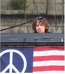 Adam MacDougall performing with The Black Crowes at the 2008 Newport Folk Festival.