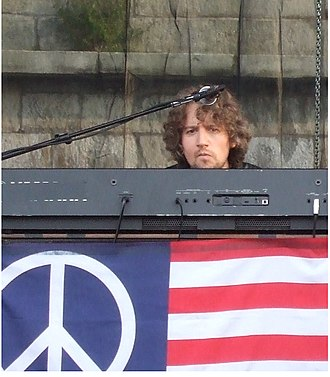 Adam MacDougall (musician) - Adam MacDougall performing with The Black Crowes at the 2008 Newport Folk Festival.