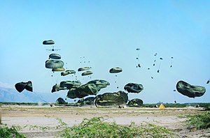 Airdrop - A C-17 military transport airplane drops humanitarian aid load,  dealing with the aftermath of the 2010 Haiti earthquake
