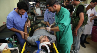 Casualties of the Syrian Civil War - Doctors and medical staff treating injured rebel fighters and civilians in Aleppo