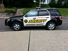 A marked 2009 Ford Escape Canine Unit vehicle.