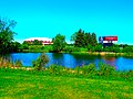 Alliant Energy Center Pond and Welcome Sign - panoramio.jpg