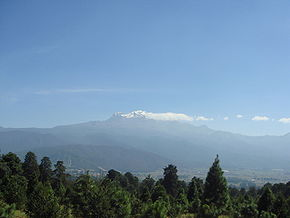 Amecameca with Popocat�petl and Iztaccihuatl volcanos in the background.