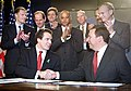 Andrew Cuomo and Lawrence Summers shake hands.jpg