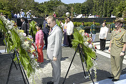 The President of the Philippines, Gloria Macapagal-Arroyo, and the Honorable Francis J. Ricciardone, Jr., U.S. Ambassador to the Philippines, along with dignitaries from the United Kingdom, Australia, New Zealand and the Philippines participate in a wreath laying ceremony during the 60th Leyte Gulf Landings Anniversary commemoration at MacAurthur Landing Memorial National Park, Palo, Leyte, Philippines, Oct. 20, 2004