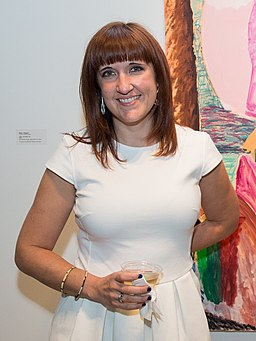 Artist Shara Hughes with one of her paintings
