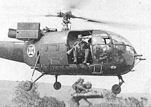 Armed soldier in a helicopter
