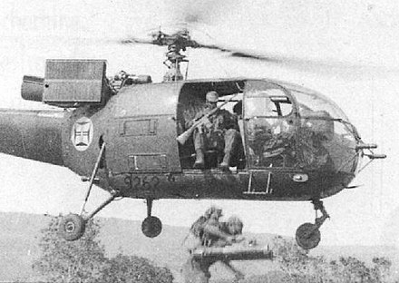Portuguese paratroopers jump from an Alouette III in an air assault operation in Angola in the early 1960s. AssaltonaMatadaSanga....jpg