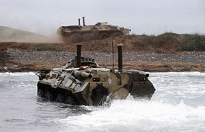 BTR-80 - A Russian BTR-80 makes its way ashore from a Ropucha-class landing ship during a combined American-Russian disaster relief exercise in June 1994 near Vladivostok
