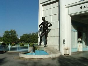 """Spa town - The statue of """"A man breaking a walking crutch"""" in the spa town Piešťany (Slovakia) – a symbol of balneotherapy"""