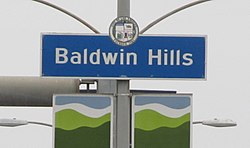 Baldwin Hills signage located at the intersection of La Brea Avenue and Stocker Street