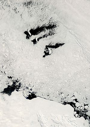 Balleny Islands - The Balleny Islands (top) and Antarctic coast (bottom) from space, December 2007. Dark patches are ice-free sea surface.