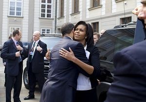 President Barack Obama embraces First Lady Mic...
