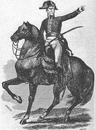 Black-and-white print of a man on horseback holding a saber and pointing to the viewer's right. He wears a dark coat of early 1800s style, white breeches, black boots, and a bicorne hat worn side-to-side.
