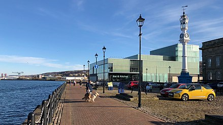 The Beacon Arts Centre, with the Gallery Suite and cafe / bistro looking out over the Custom House Quay waterfront and the Clyde. Beacon Arts Centre & clock tower w.jpg