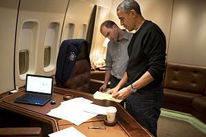 Ben Rhodes (White House staffer) - President Barack Obama and Rhodes on board Air Force One, editing the speech for the Mandela memorial service.