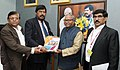 Bhiku Ramji Idate handing over its report to the Minister of State for Social Justice & Empowerment, Shri Ramdas Athawale, in New Delhi.jpg