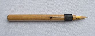Writing implement - A wooden pencil extender.