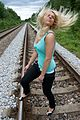 Blond woman on rail tracks 02.jpg