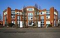 Bodenheim- Am Kümmerling- Fassade der Hausnummern 24–26 (Deutsche Umschlaggesellschaft Schiene-Straße) 26.1.2017.jpg