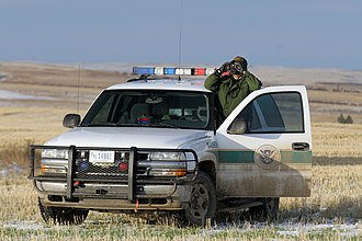 Patrol - U.S. Border Patrol agent monitoring the U.S.-Canada border in Montana. Many more agents are stationed at the US Mexico border to combat illegal immigration
