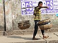 Boy Bearing Baskets - Sylhet - Bangladesh (12988833804).jpg