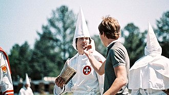Auburn, Alabama - Local artist Bruce Larsen (foreground) confronts a Ku Klux Klan member at an Auburn rally in 1986.