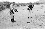 Buzz (left) takes a handheld documentation photo while Neil appears to be using the tongs to collect a sample.jpg