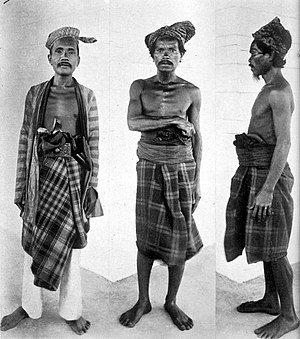 Muna Island -  Three men from the Island of Muna, on the left stands a nobleman and in the centre and to the right are two men from the Reha people